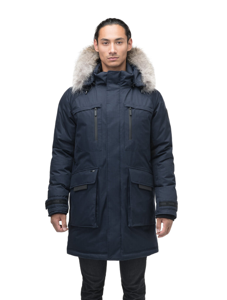 Men's thigh length down-filled parka with removable hood and removable coyote fur trim in Navy| color
