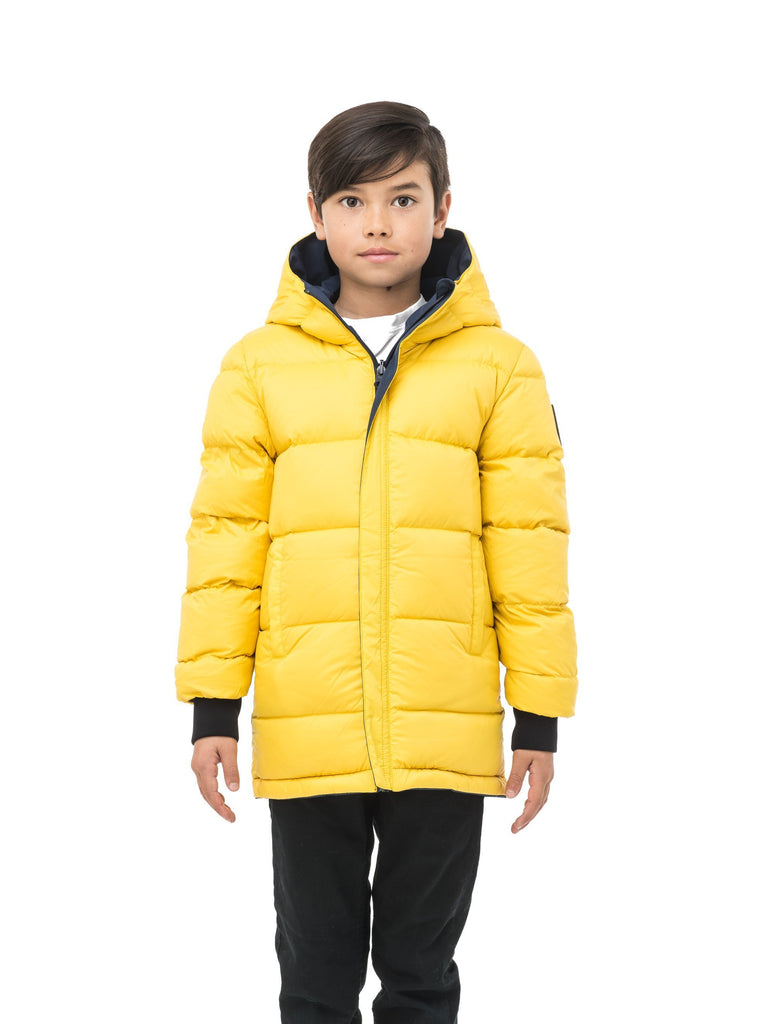 Kids' reversible knee length, down filled parka with waterproof finish in Marine/Citron| color