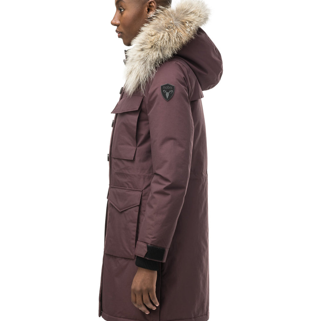 Women's knee length down filled parka with two chest patch pockets and two waist patch pockets in Burgundy | color