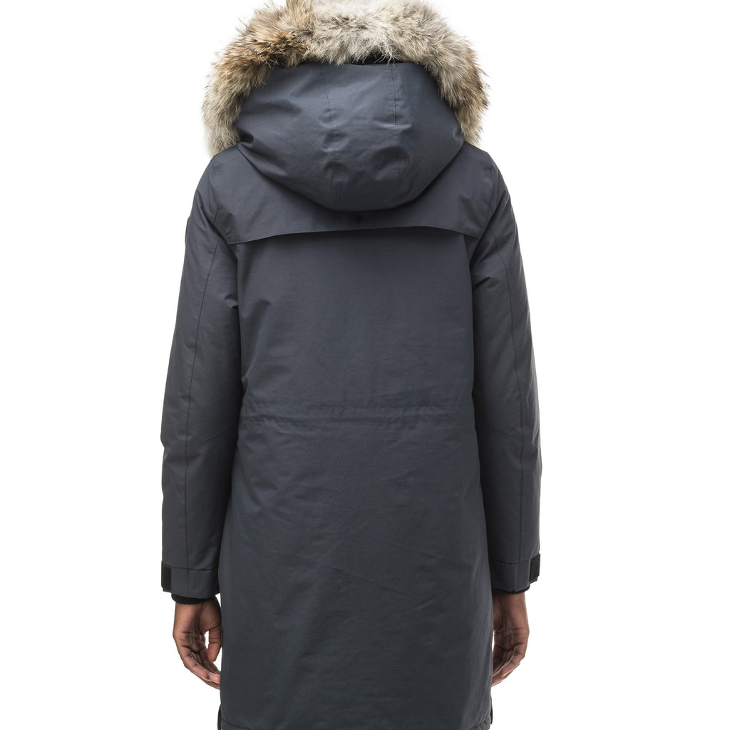Women's knee length down filled parka with two chest patch pockets and two waist patch pockets in Navy | color