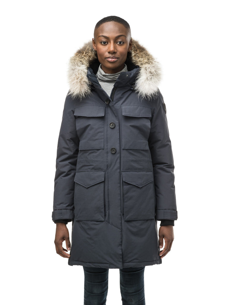 Women's knee length down filled parka with two chest patch pockets and two waist patch pockets in Navy| color