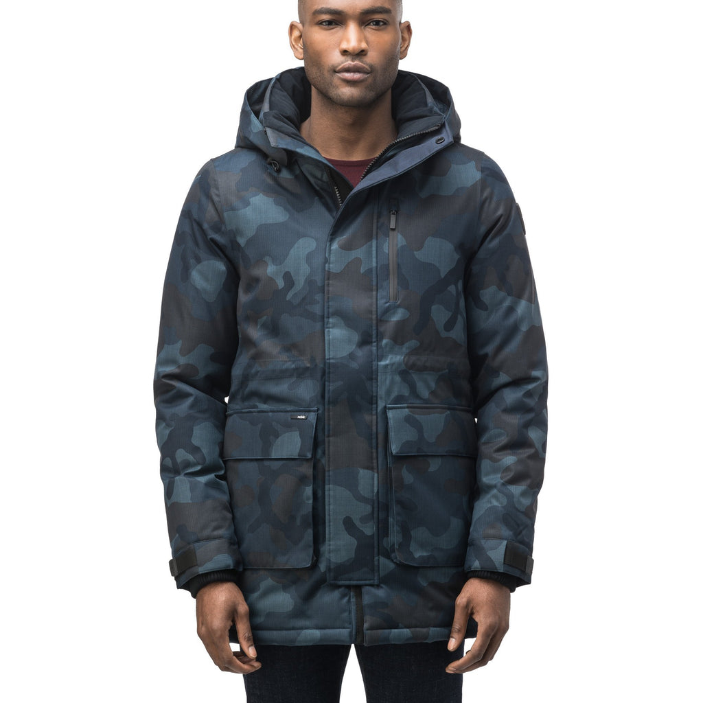 Mid weight men's down filled parka with two patch pockets at the hip and snap closure side vents in Navy Camo | color