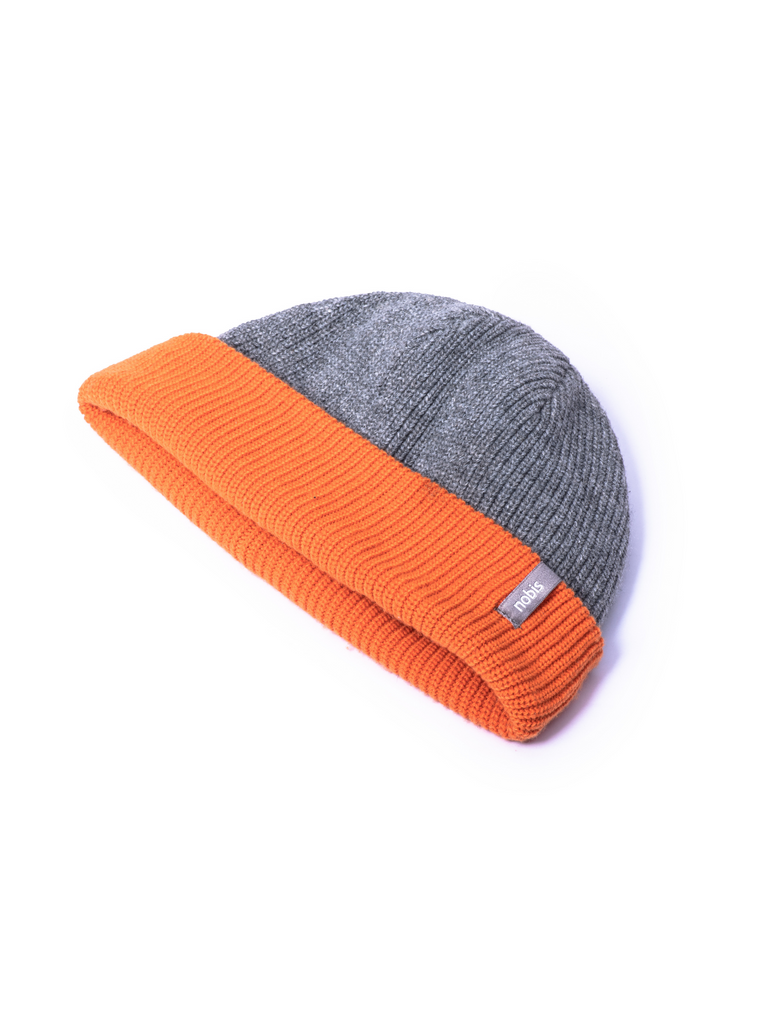 Knitted reversible beanie with grey side displayed.| color