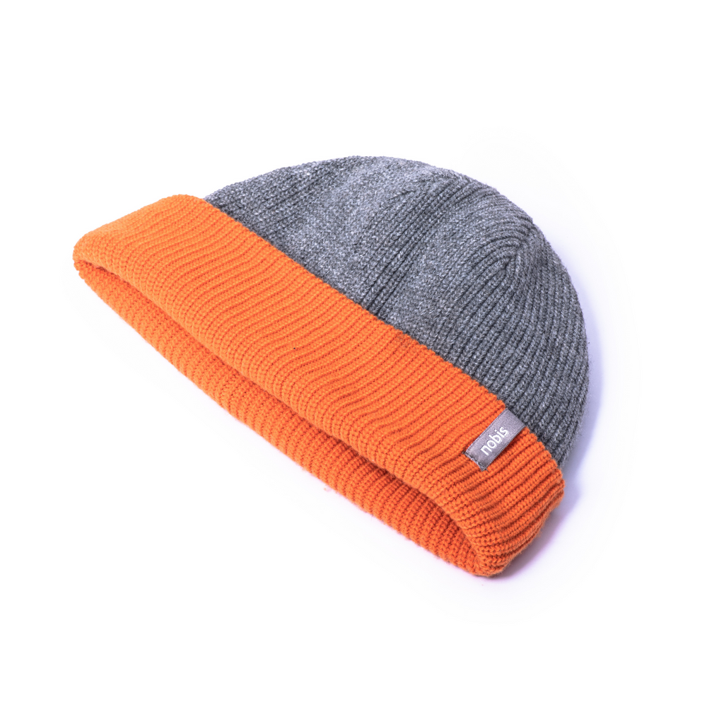 Knitted reversible beanie with grey side displayed. | color