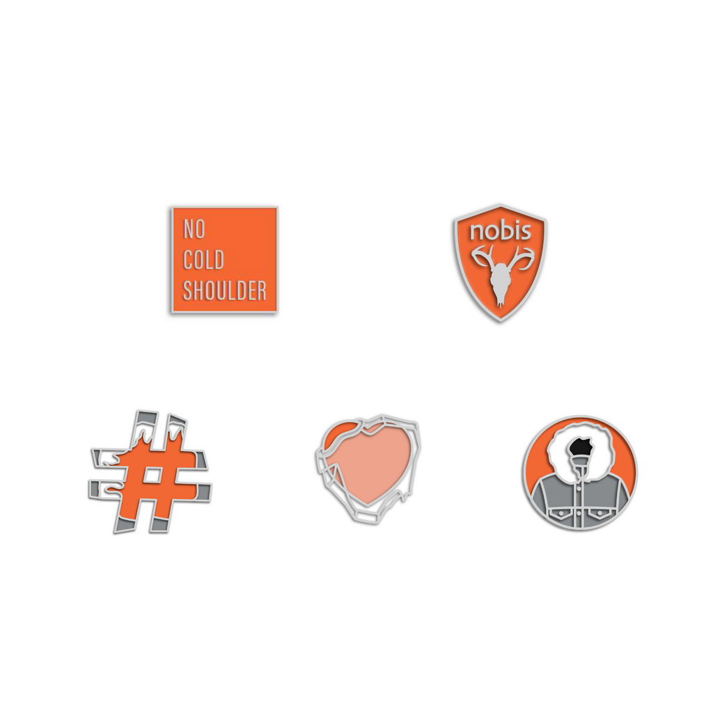 Set of five enamel pins that include an orange square with no cold shoulder printed in the center, and orange nobis logo shield, and orange and grey hashtag, an orange heart with ice over it and a Atomic and grey circle parka Pin Pack | color