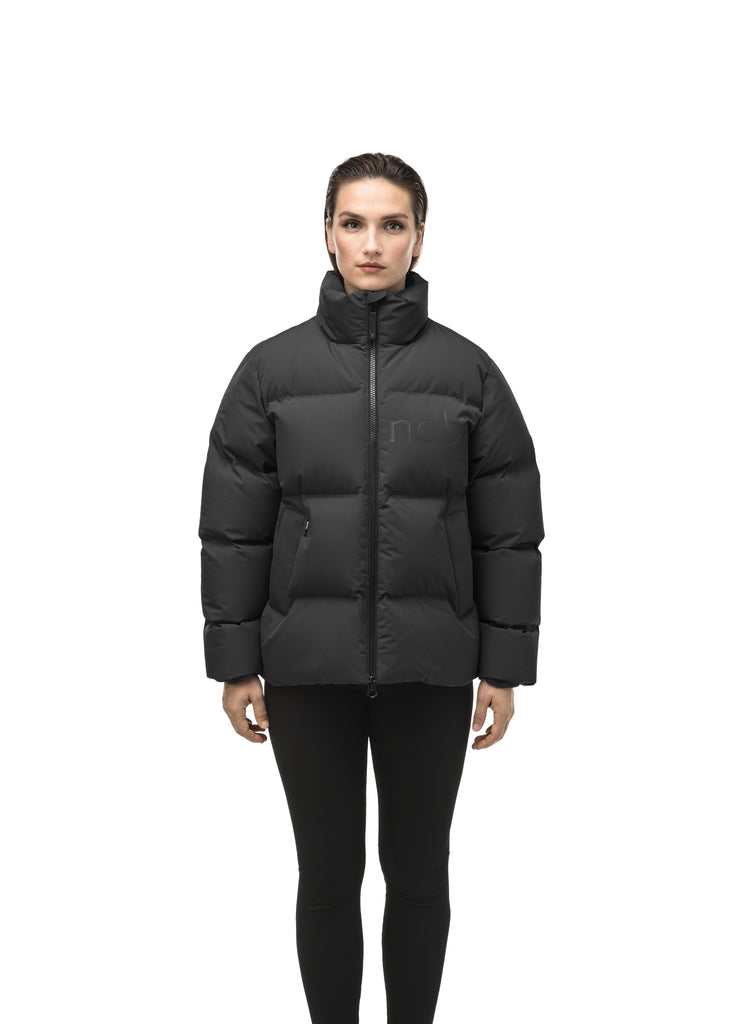 Women's puffer jacket with a minimalist modern design; featuring graphic details like oversized tonal branding, an exposed zipper, and seamless puffer channels to lock in the Premium Canadian Origin White Duck Down in Black| color