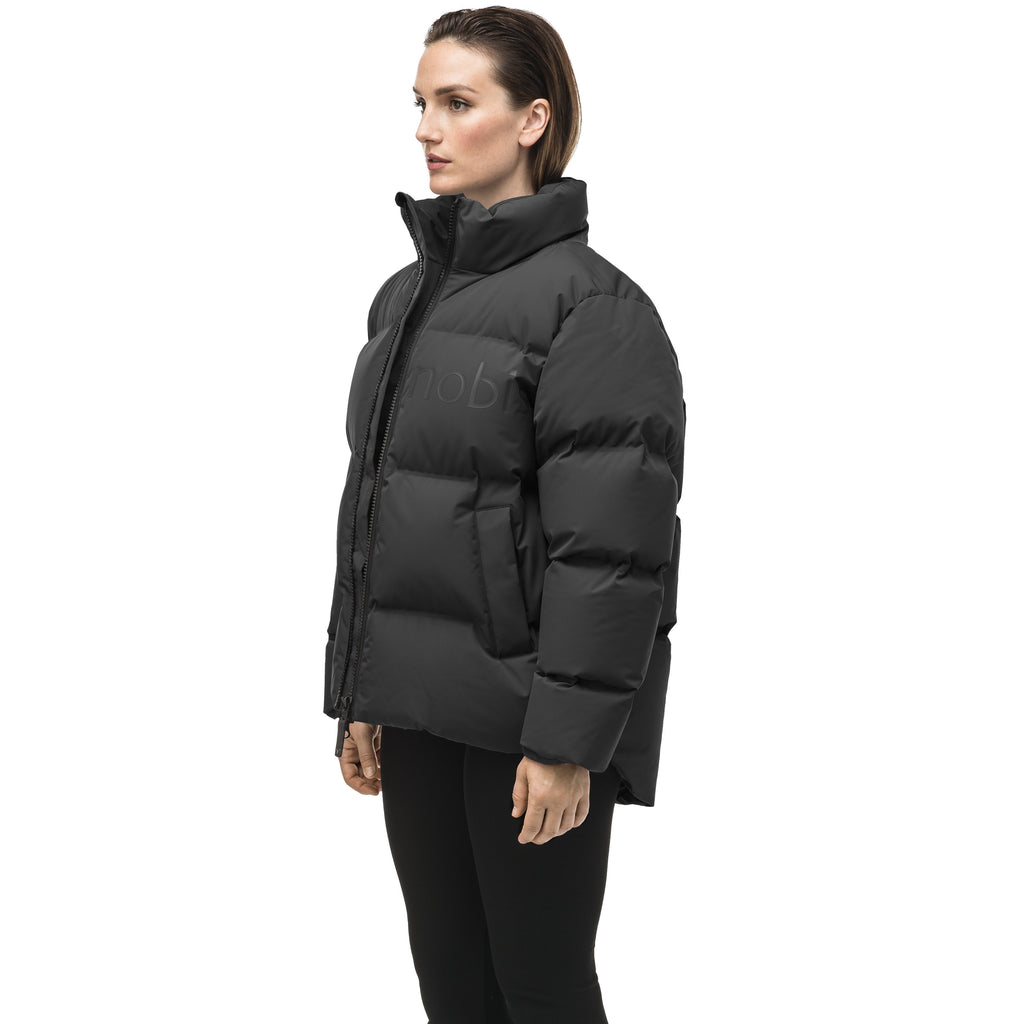Women's puffer jacket with a minimalist modern design; featuring graphic details like oversized tonal branding, an exposed zipper, and seamless puffer channels to lock in the Premium Canadian Origin White Duck Down in Black | color
