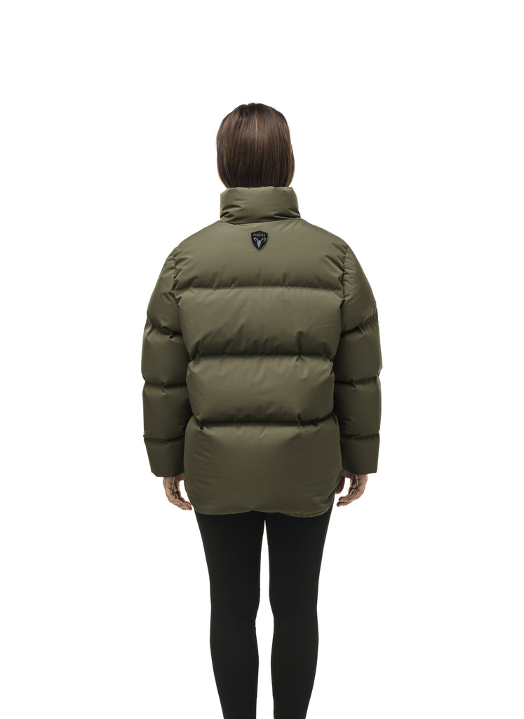 Women's puffer jacket with a minimalist modern design; featuring graphic details like oversized tonal branding, an exposed zipper, and seamless puffer channels to lock in the Premium Canadian Origin White Duck Down in Fatigue| color