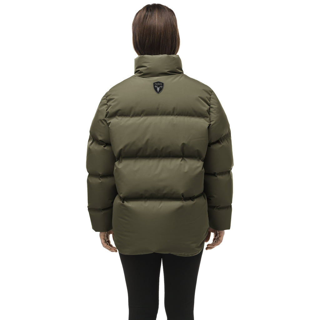 Women's puffer jacket with a minimalist modern design; featuring graphic details like oversized tonal branding, an exposed zipper, and seamless puffer channels to lock in the Premium Canadian Origin White Duck Down in Fatigue | color