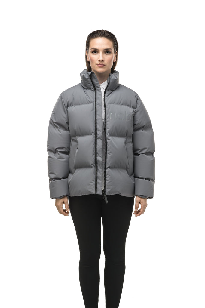 Women's puffer jacket with a minimalist modern design; featuring graphic details like oversized tonal branding, an exposed zipper, and seamless puffer channels to lock in the Premium Canadian Origin White Duck Down in Concrete color| color