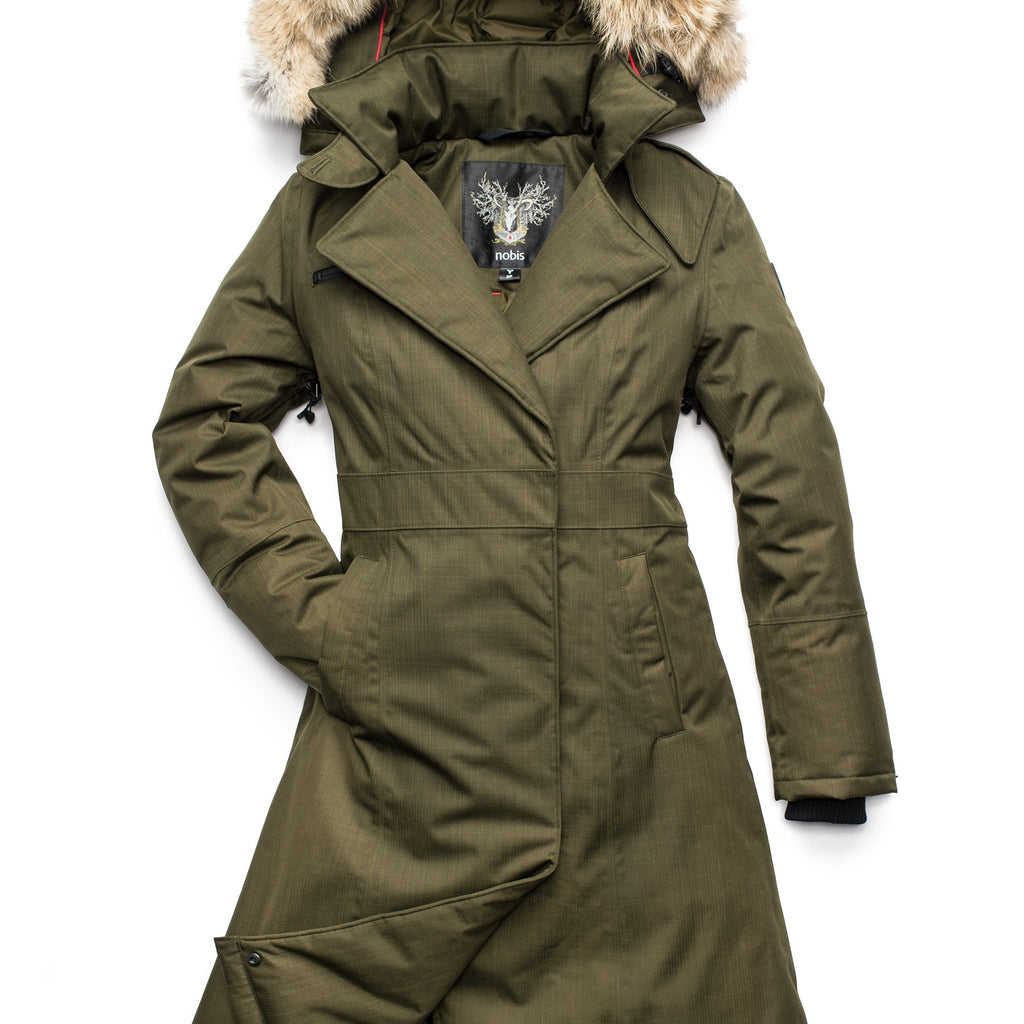 Long calf length women's trench inspired parka with removable fur trim around the hood and an asymetric closure in Fatigue | color