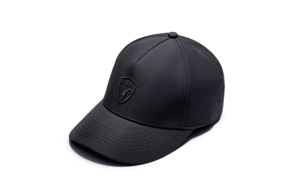 Five panel baseball hat with adjustable back in Black| color