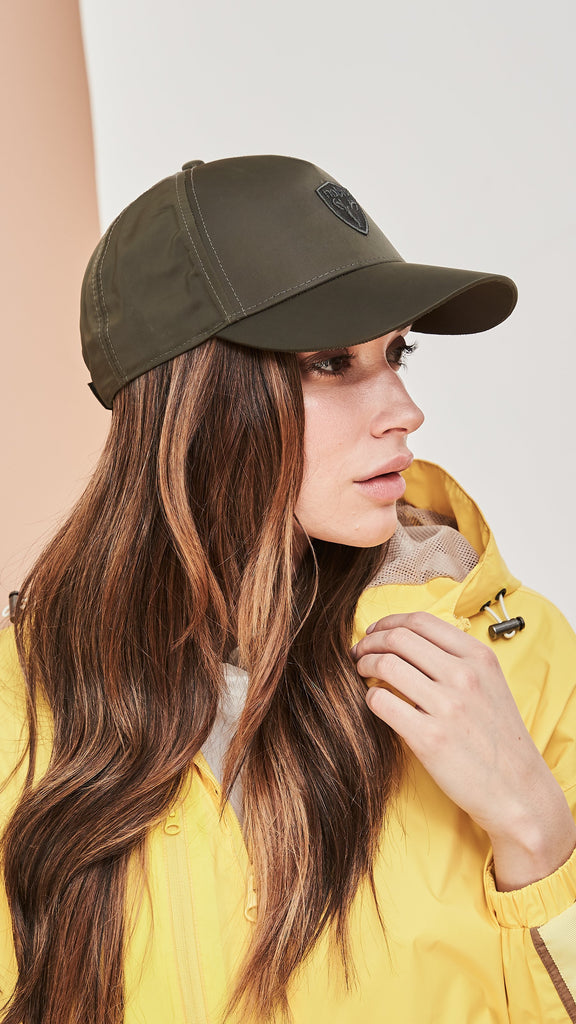Model wearing five panel baseball hat with adjustable back in Fatigue| color