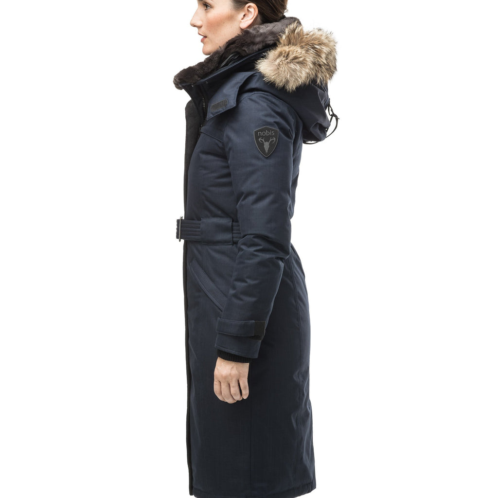 Women's knee length down filled parka with a belted waist and fully removable Coyote and Rex Rabbit fur ruffs in CH Navy | color