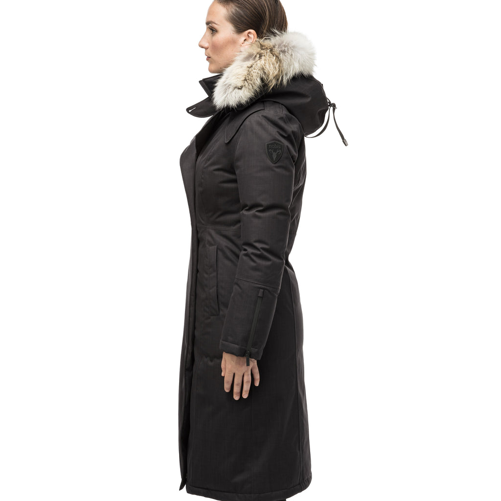 Long calf length women's trench inspired parka with removable fur trim around the hood and an asymetric closure in Black | color