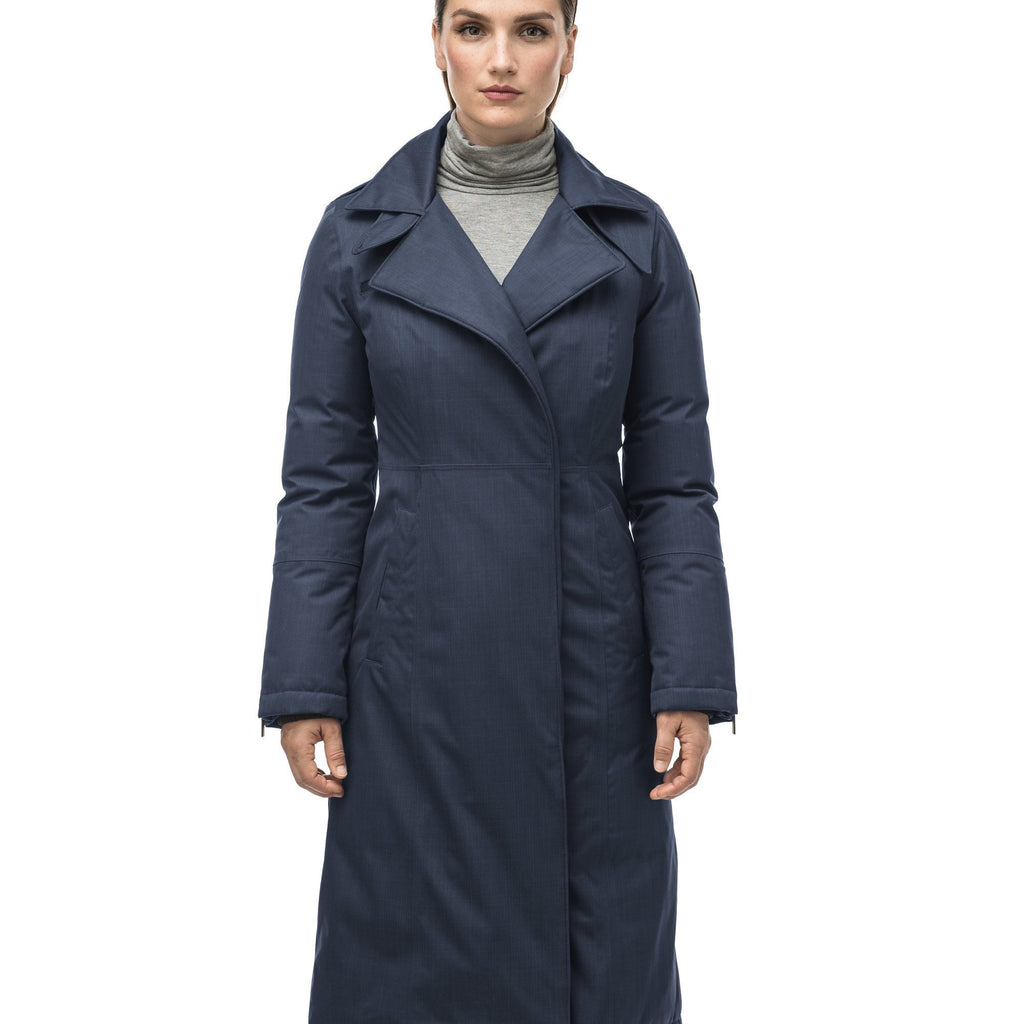 Long calf length women's trench inspired parka with removable fur trim around the hood and an asymetric closure in Navy | color