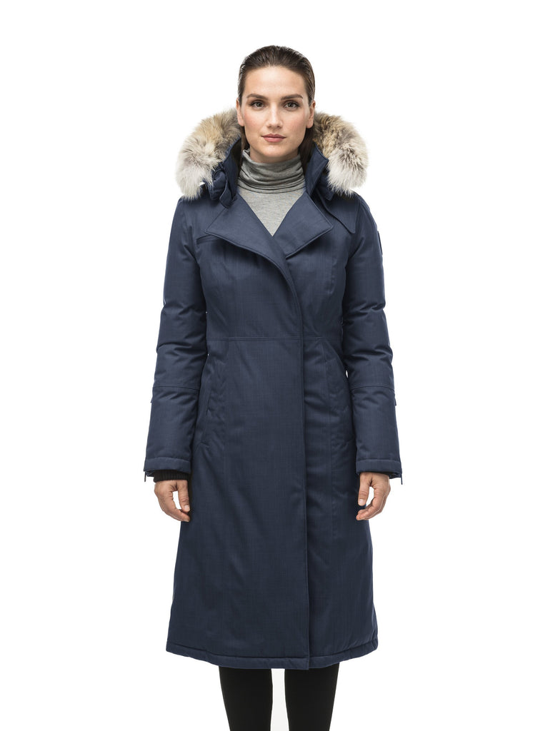 Long calf length women's trench inspired parka with removable fur trim around the hood and an asymetric closure in Navy| color