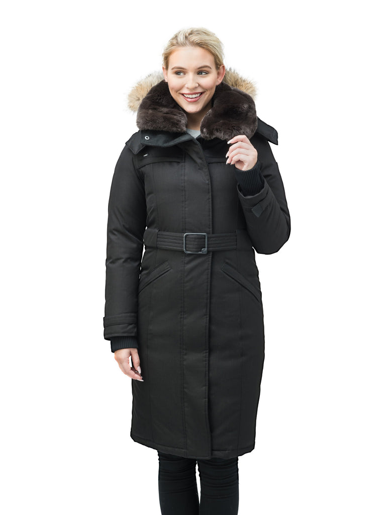 Women's knee length down filled parka with a belted waist and fully removable Coyote and Rex Rabbit fur ruffs in CH Black| color