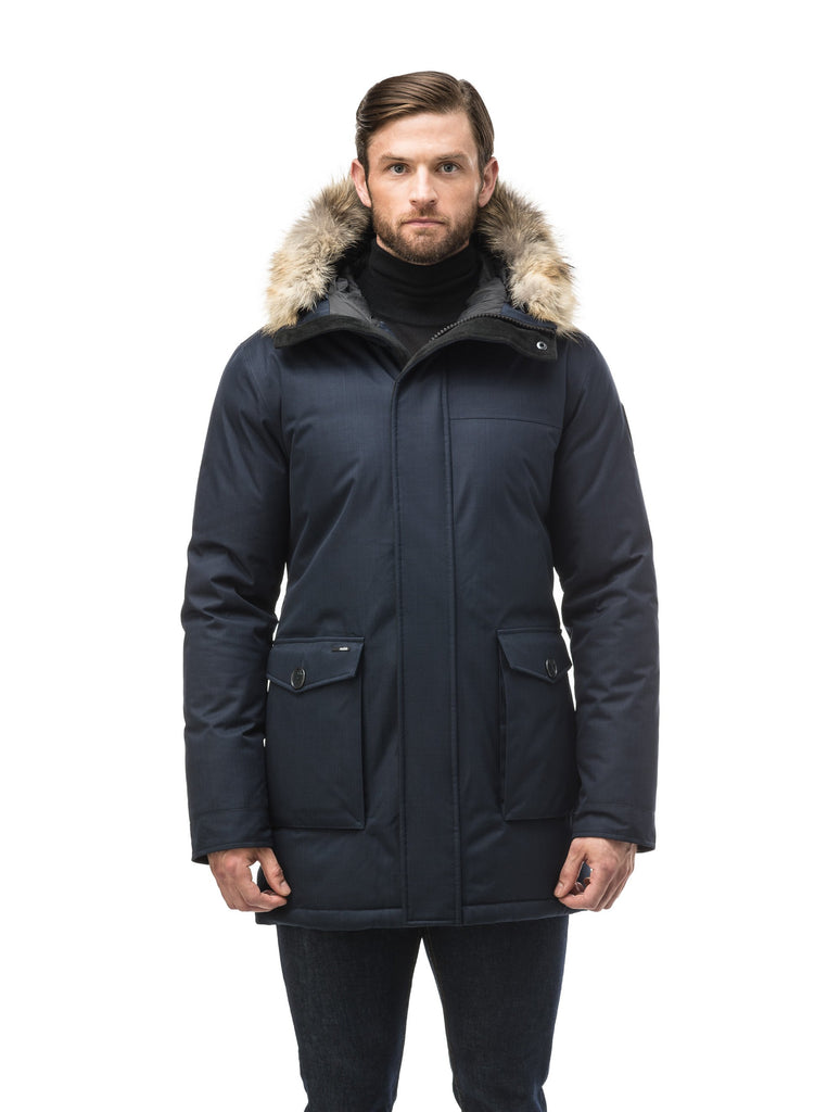 Men's slim fitting waist length parka with removable fur trim on the hood and two waist patch pockets in CH Navy| color