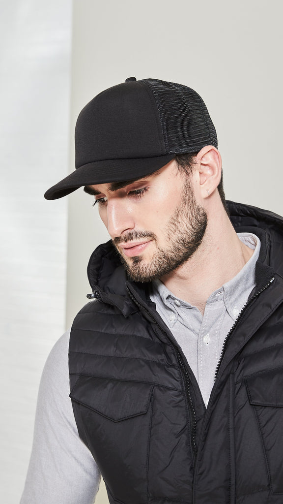 Six panel ball cap with two solid front panels and four mesh back panels in Black| color