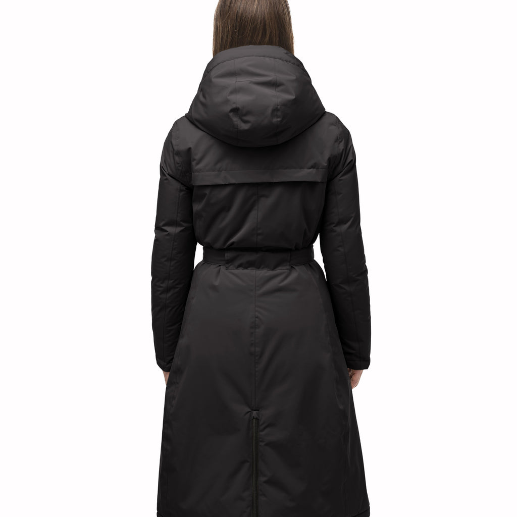 Long calf length hooded women's winter parka with an inner hip length closure, exterior hem length zipper and magentic placket in Black | color
