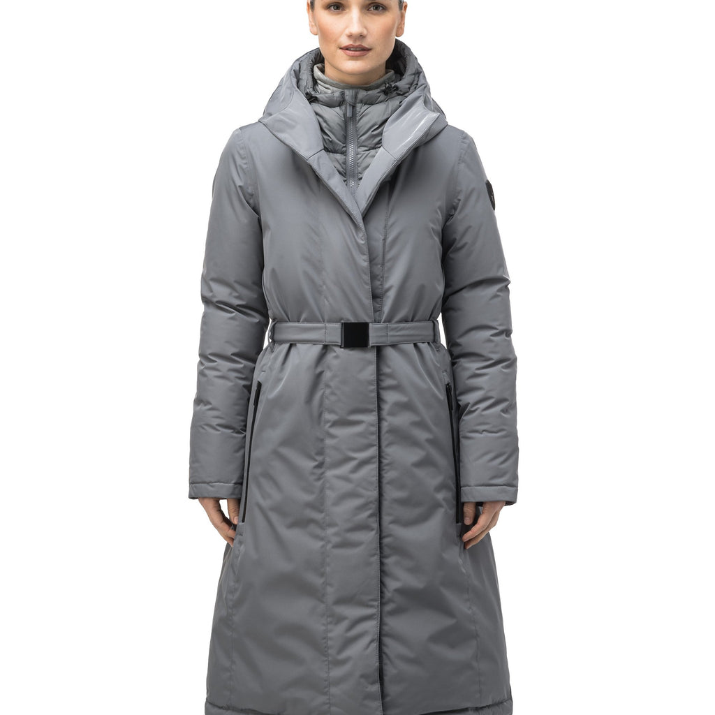 Long calf length hooded women's winter parka with an inner hip length closure, exterior hem length zipper and magentic placket in Concrete | color