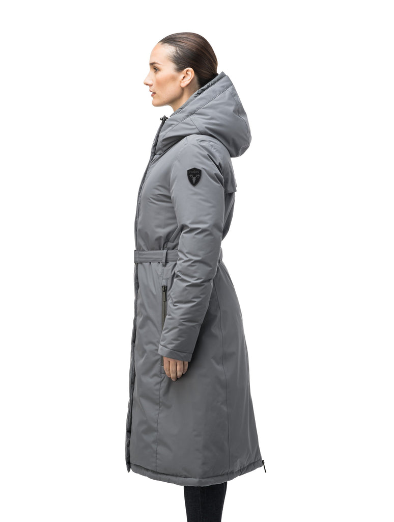 Long calf length hooded women's winter parka with an inner hip length closure, exterior hem length zipper and magentic placket in Concrete| color