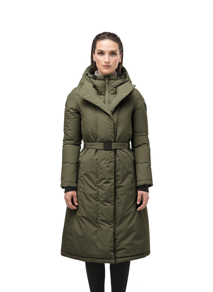 Long calf length hooded women's winter parka with an inner hip length closure, exterior hem length zipper and magentic placket in Fatigue| color