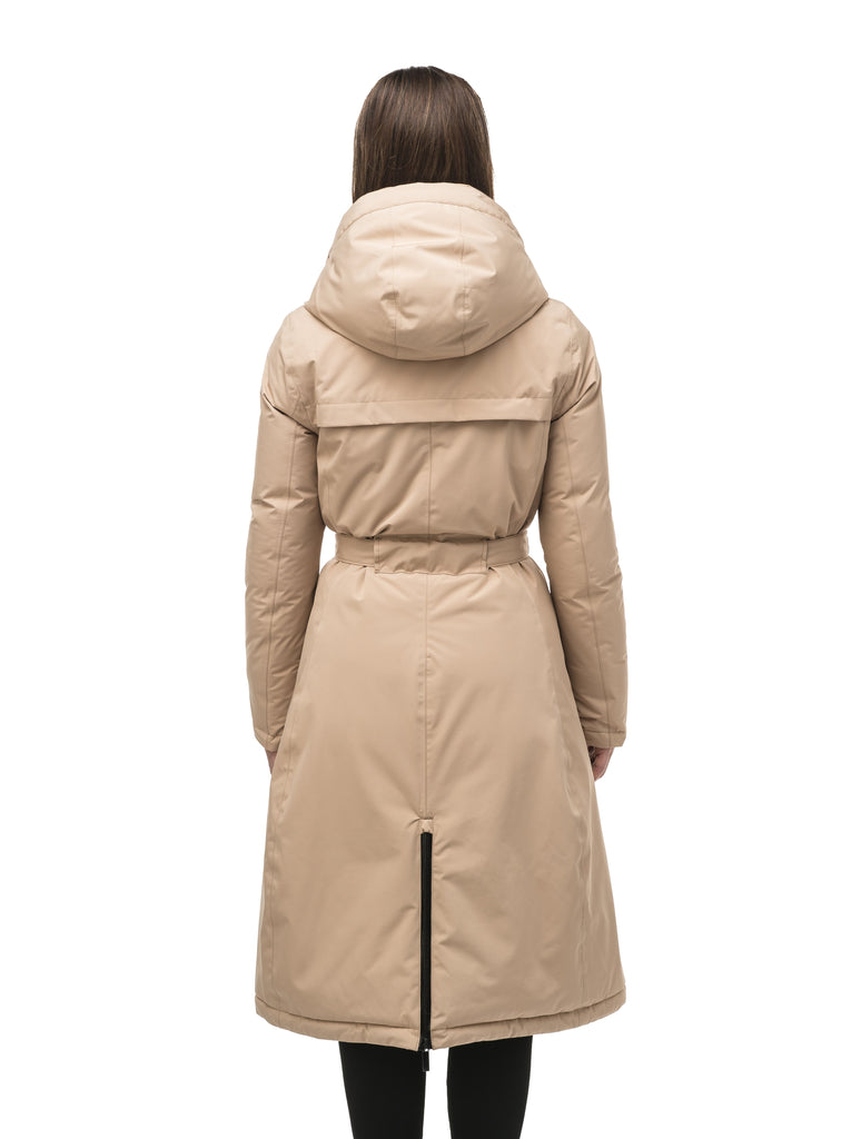 Long calf length hooded women's winter parka with an inner hip length closure, exterior hem length zipper and magentic placket in Fawn| color