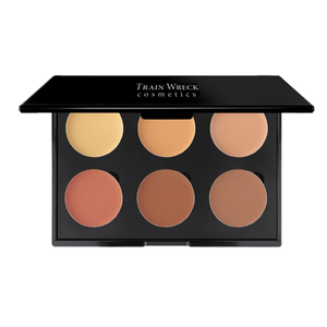 Train Wreck Cosmetics Revolutionary Corrector Palette 6 Well for medium dark skin tones.