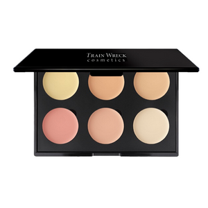 Train Wreck Cosmetics Revolutionary Corrector Palette 6 Well for light to medium skin tones.