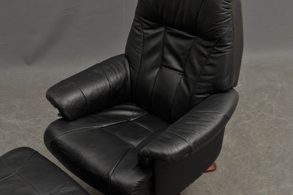 Swivel Leather / Rosewood Armchair and Ottoman