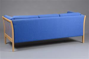 Back Side of Beech Sofa with Light Blue Upholstery