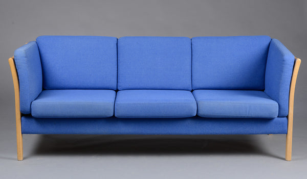 Front View of Beech Sofa with Light Blue Upholstery