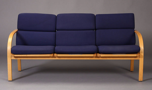 Beech Sofa with Navy Blue Cushions