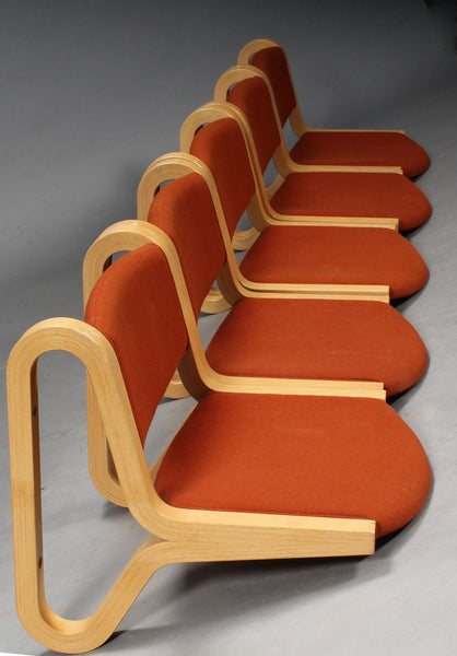 Side View of Beech Wall Hung Chairs with Red Textile Upholstery by Magnus Olesen