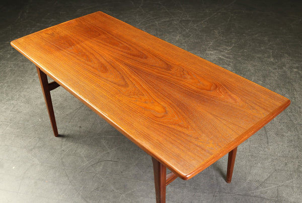 Elevating Teak Coffee Table with Extension Leaves