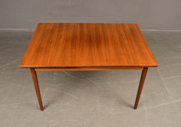 Teak Dining Table with Dutch Leaves