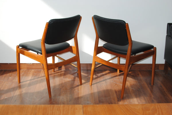 Two Black Leather Teak Frame Dining Chairs by Arne Vodder