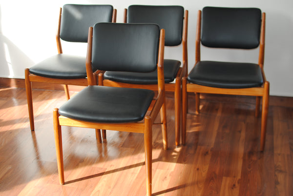 Four Black Leather Teak Frame Dining Chairs by Arne Vodder