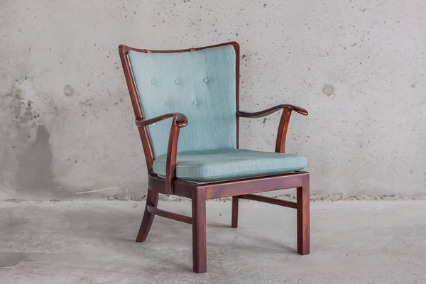 His Mahogany Armchair