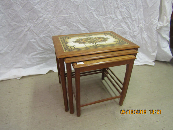 Teak nesting table with hand-painted ceramic tiles from Denmark.