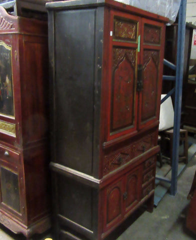 Red Painted Antique Cabinet with Intricate Carvings and Brass Fixtures