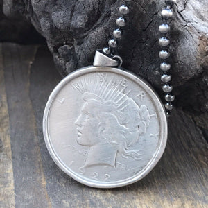 Sterling  Silver incased Liberty Coin Pendant.