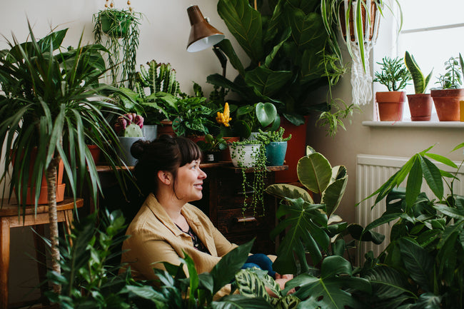 Kate Chilver of Tribe and Us surrounded by plants