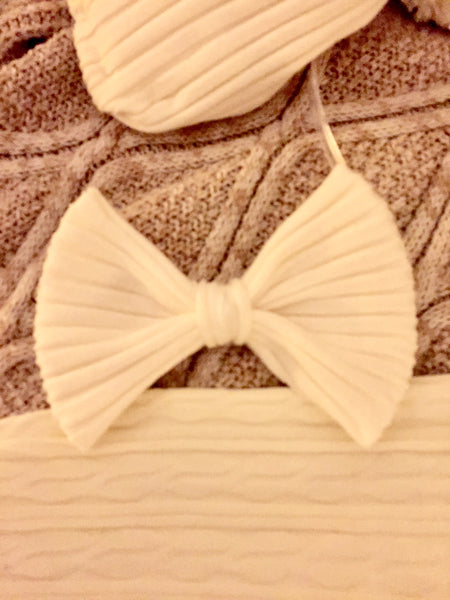 white sweater hairbow