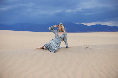 Astrobandit wearing Dreamers and Drifters grey wrap dress in the sand