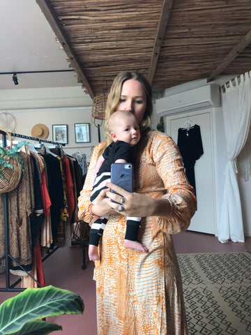 Baby at boutique with designer working mum Byron Bay