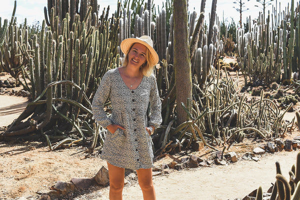 Verity, Head Designer of Dreamers & Drifters, in long sleeve babydoll dress Cheetah at Cactus Country