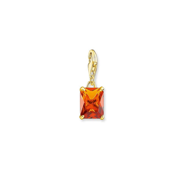 Gold-finish charm with bright orange stone